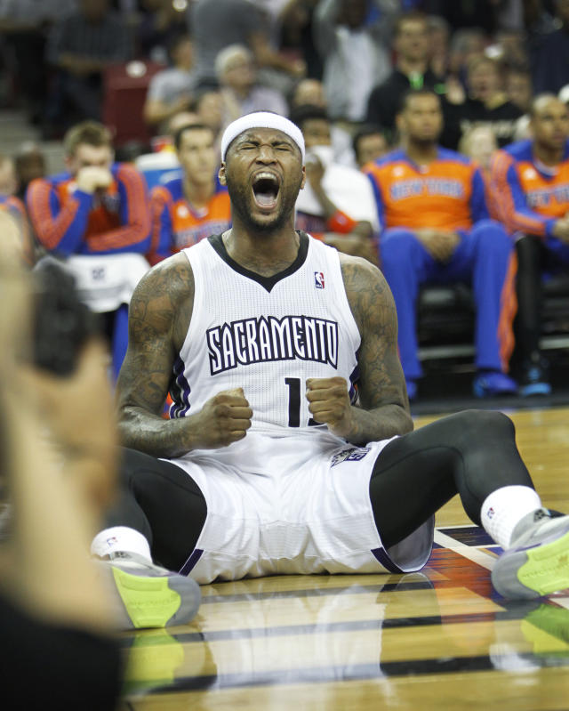 Sacramento Kings center DeMarcus Cousins reacts after being fouled while scoring against the New York Knicks during the second half of an NBA basketball game in Sacramento, Calif., on Wednesday, March 26, 2014.The Knicks won 107-99.(AP Photo/Steve Yeater)