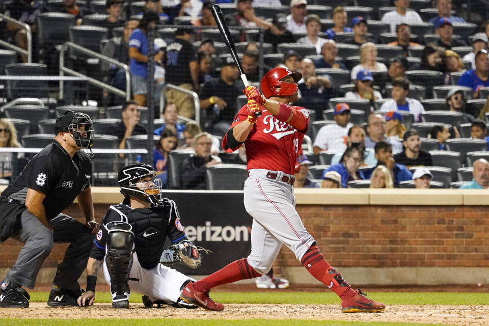 Cincinnati Reds' Joey Votto, right, watches his solo home run in the sixth inning of the baseball game against the New York Mets, Friday, July 30, 2021, in New York. (AP Photo/Mary Altaffer)
