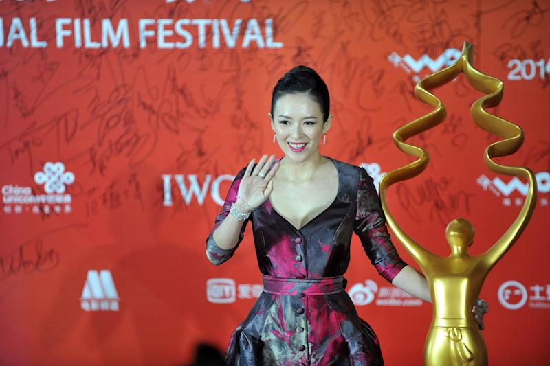 File photo taken on April 23, 2014 shows actress Zhang Ziyi arriving on the red carpet for the Beijing Interntional Film Festival awards ceremony