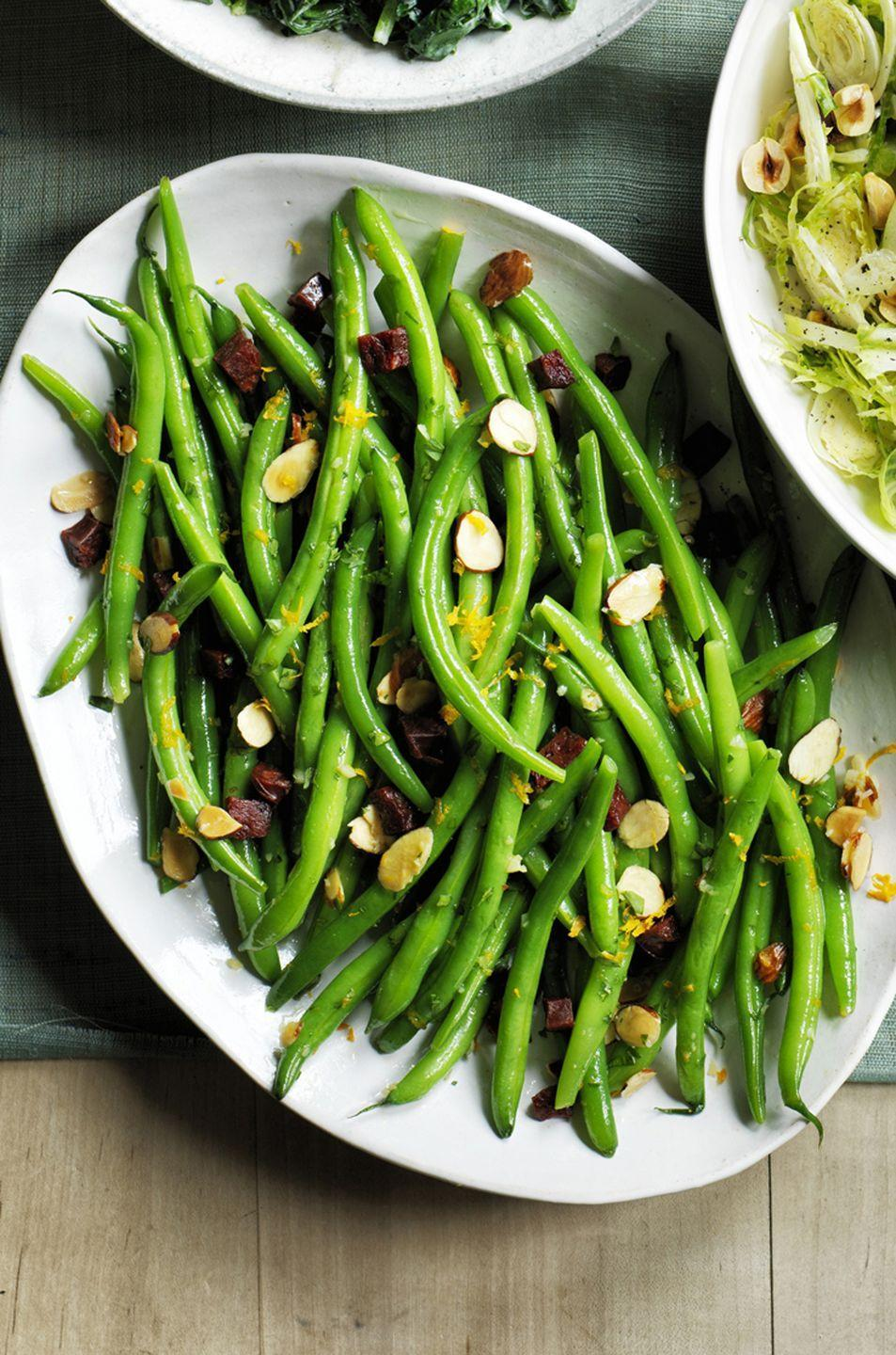 """<p>Instead of a classic green bean casserole, beef up your the thin beans with chorizo. </p><p><em><strong><a href=""""https://www.womansday.com/food-recipes/food-drinks/recipes/a60489/green-beans-with-chorizo-and-almond-crumbs-recipe/"""" rel=""""nofollow noopener"""" target=""""_blank"""" data-ylk=""""slk:Get the Green Beans with Chorizo and Almond Crumbs recipe."""" class=""""link rapid-noclick-resp"""">Get the Green Beans with Chorizo and Almond Crumbs recipe.</a></strong></em></p>"""