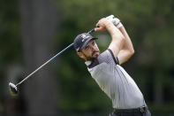 Troy Merritt drives off the fourth tee during the third round of the Rocket Mortgage Classic golf tournament, Saturday, July 3, 2021, at the Detroit Golf Club in Detroit. (AP Photo/Carlos Osorio)