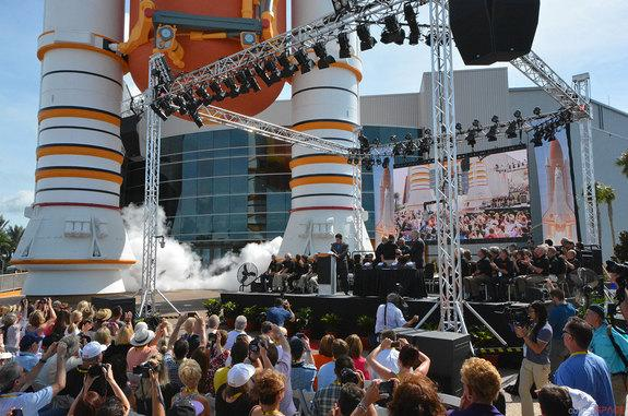 """Smoke billows from the replica solid rocket boosters outside the new """"Space Shuttle Atlantis"""" exhibit, marking the """"launch"""" of the Kennedy Space Center Visitor Complex attraction in Florida, June 29, 2013."""
