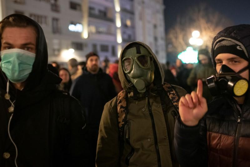 Serbians don masks and take to smog-filled streets to demand cleaner air