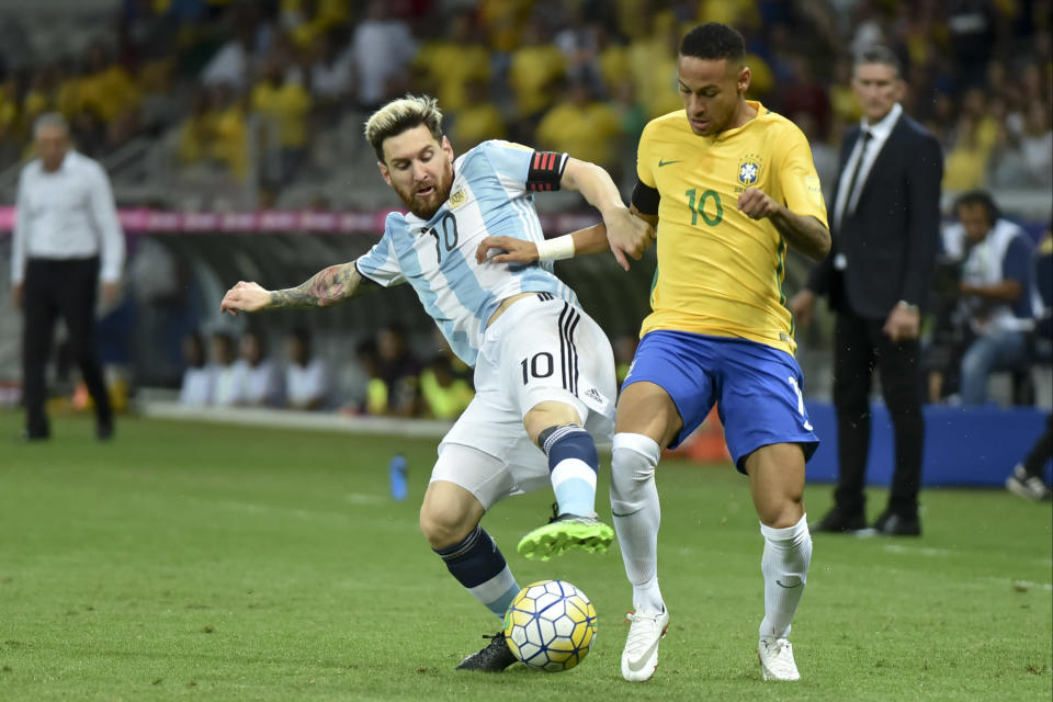 Argentina's Lionel Messi and Brazil's Neymar would both be described as forwards, but not necessarily strikers – though Messi has become one at times during his career. (Getty)