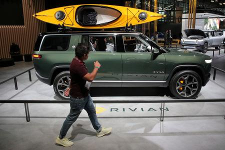 FILE PHOTO: FILE PHOTO: A Rivian R1S All-Electric SUV is displayed at the 2019 New York International Auto Show in New York City, U.S, April 17, 2019. REUTERS/Brendan McDermid/File Photo