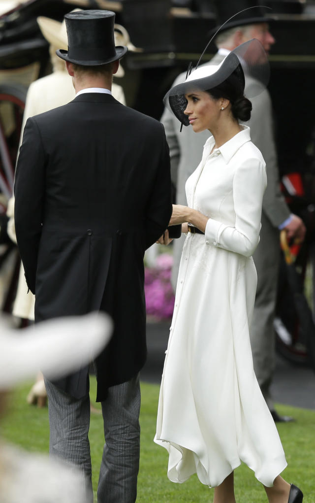 The Duke and Duchess of Sussex cut a stylish figure at the racing event. (Photo: AP Photo/Tim Ireland)