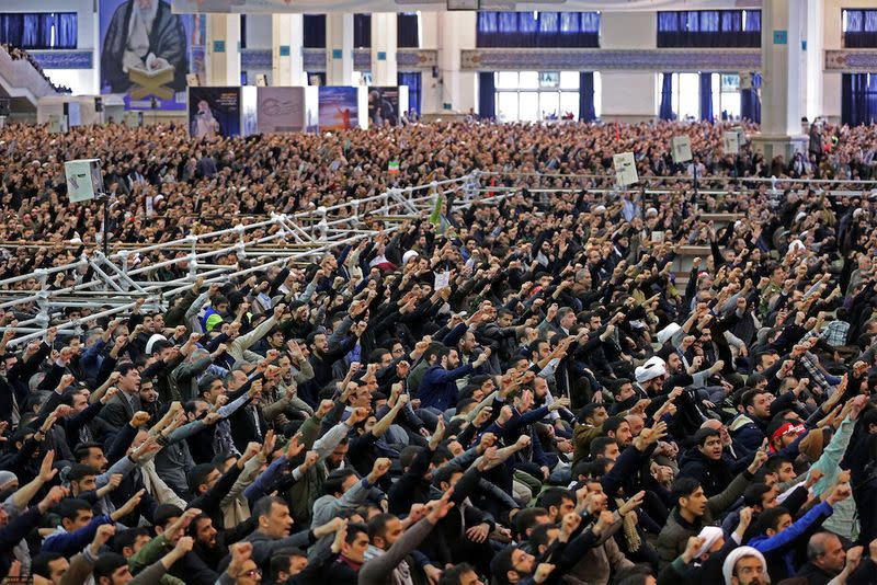 Iranian worshippers chant slogans during the Friday prayers sermon led by Iran's Supreme Leader Ayatollah Ali Khamenei, in Tehran