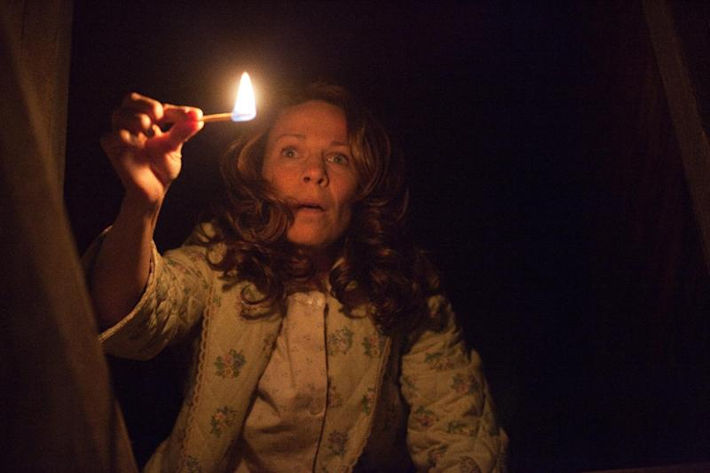 """In this publicity image released by Warner Bros. Pictures, Lili Taylor portrays Carolyn Perron in a scene from """"The Conjuring."""" (AP Photo/New Line Cinema/Warner Bros. Pictures, Michael Tackett)"""
