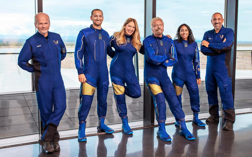 Virgin Galactic CEO Richard Branson and the crew who will be on board Sunday's test flight pictured.
