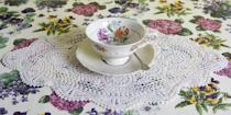 """<p>While we're on the subject of lace, just ditch the lace doilies, too. Especially when paired with a floral tablecloth, they simply read """"too much."""" </p>"""