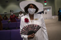 A women wearing a face mask attends a church service at the New Horizon International Church, Sunday, Oct. 4, 2020, in Jackson, Miss. The virus ripped through Mississippi's Black community early in the pandemic. About 60% of infections and deaths were among African Americans, who make up 38% of the state's population. (AP Photo/Wong Maye-E)