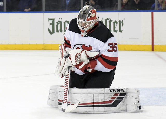 New Jersey Devils goaltender Cory Schneider stops the puck during the second period of an NHL hockey game against the New York Rangers Saturday, Feb. 23, 2019, at Madison Square Garden in New York. (AP Photo/ Bill Kostroun)