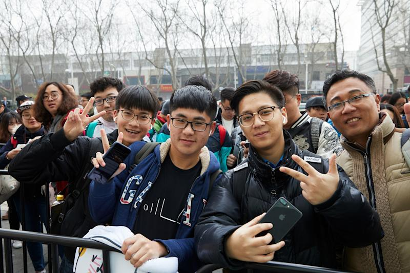 People outside an Apple Store in China.