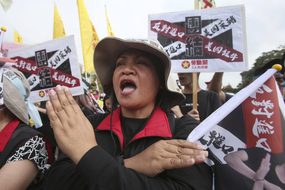 A participant shouts slogans during a protest to oppose the import of U.S. pork in Taipei, Taiwan, Sunday, Nov. 22. 2020. Thousands of people marched in streets on Sunday demanding the reversal of a decision to allow U.S. pork imports into Taiwan, alleging food safety issues. (AP Photo/Chiang Ying-ying)