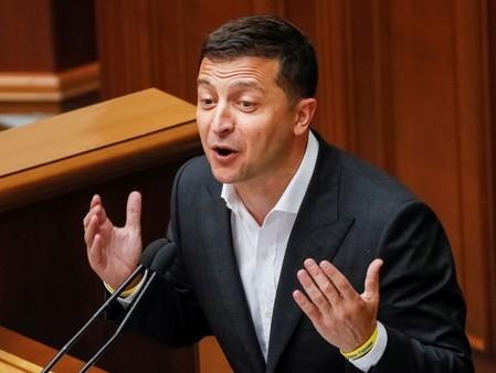 Ukrainian President Volodymyr Zelenskiy delivers a speech during a parliamentary session in Kiev