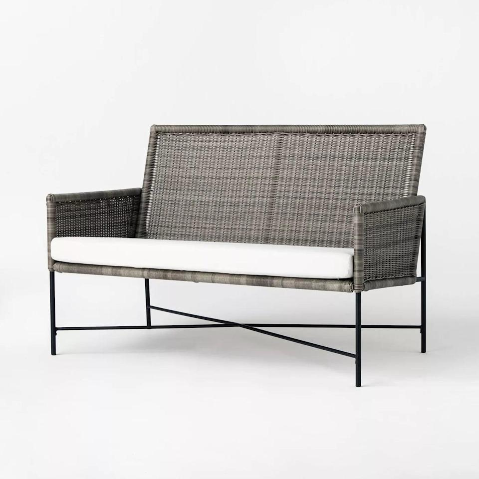 <p>Modernize your outdoor space with the <span>Wicker and Metal X Frame Patio Loveseat</span> ($300).</p>