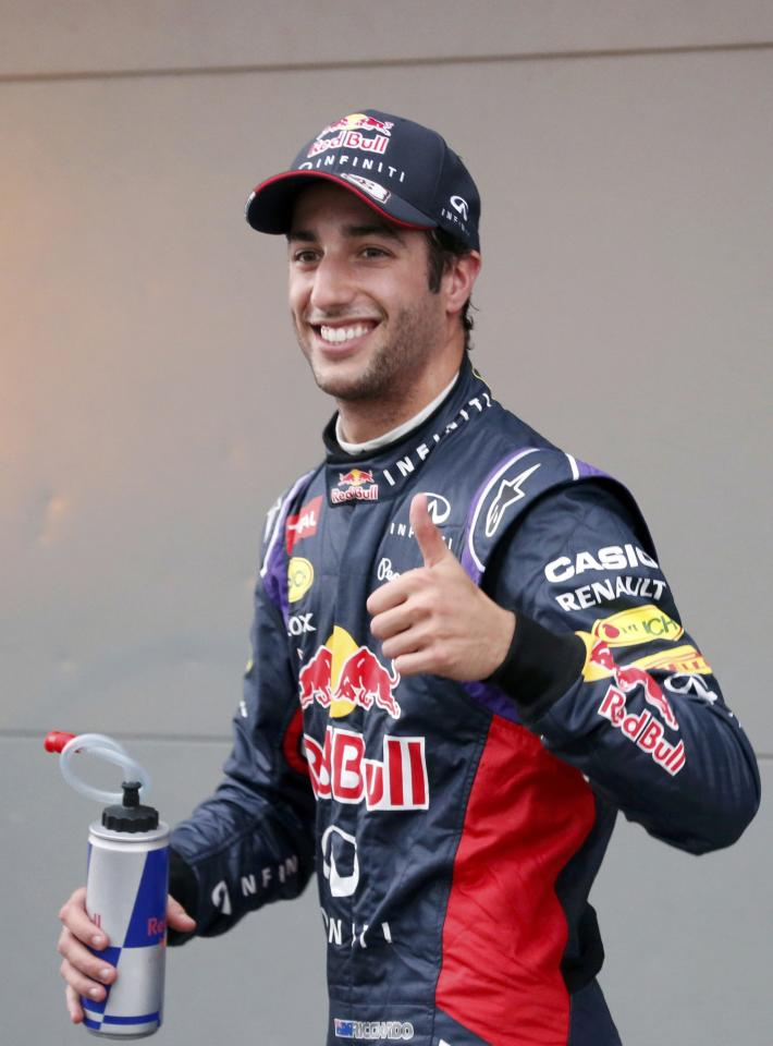 Red Bull Formula One driver Ricciardo of Australia gestures after finishing second in the qualifying session for the Australian F1 Grand Prix in Melbourne