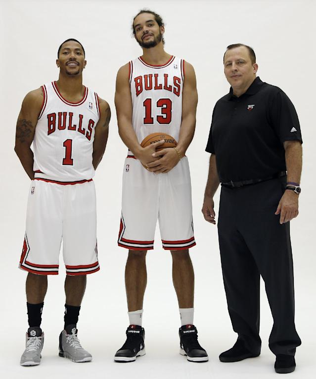 Chicago Bulls guard Derrick Rose, left, center/forward Joakim Noah, center, and head coach Tom Thibodeau pose for photos during NBA basketball media day at the Sheri L. Berto Center on Friday, Sept. 27, 2013., in Deerfield, Ill. (AP Photo/Nam Y. Huh)