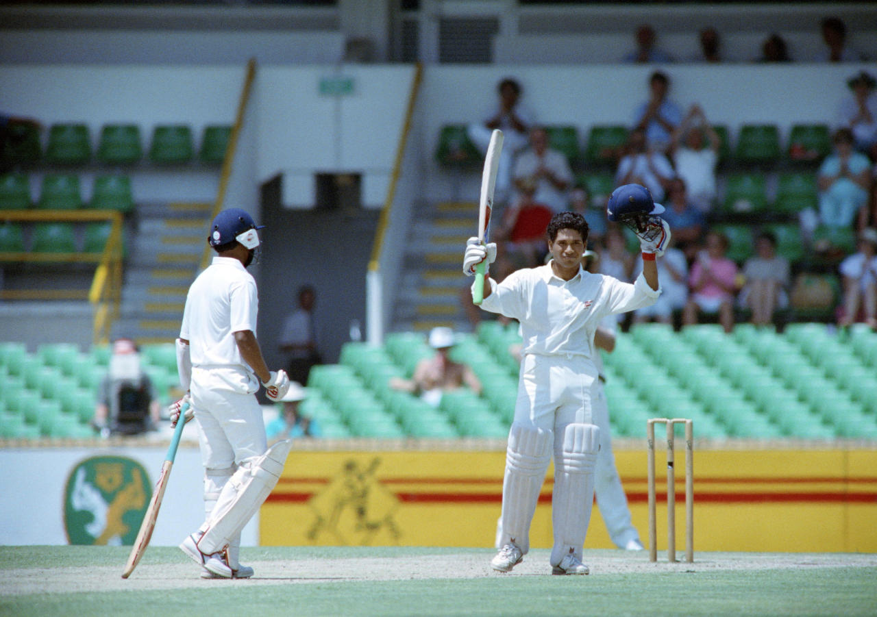 Indian batsman Sachin Tendulkar raises his bat after making a century, on february 3, 1992, during a match against Australia, in Perth.