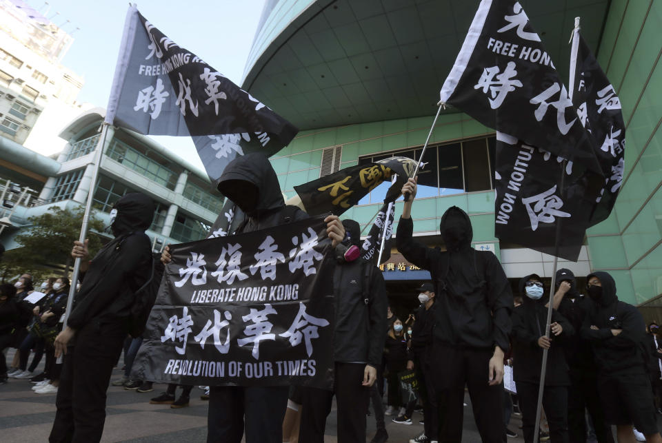 Hong Kong protesters and Taiwanese supporters gather, holding slogan to demand the release of the 12 Hong Kong protesters that have been arrested by mainland Chinese authorities, in Taipei, Taiwan, Sunday, Oct. 25, 2020. A group of 12 people from Hong Kong were allegedly traveling illegally by boat to Taiwan in August when Chinese authorities captured them and detained them.(AP Photo/Chiang Ying-ying)