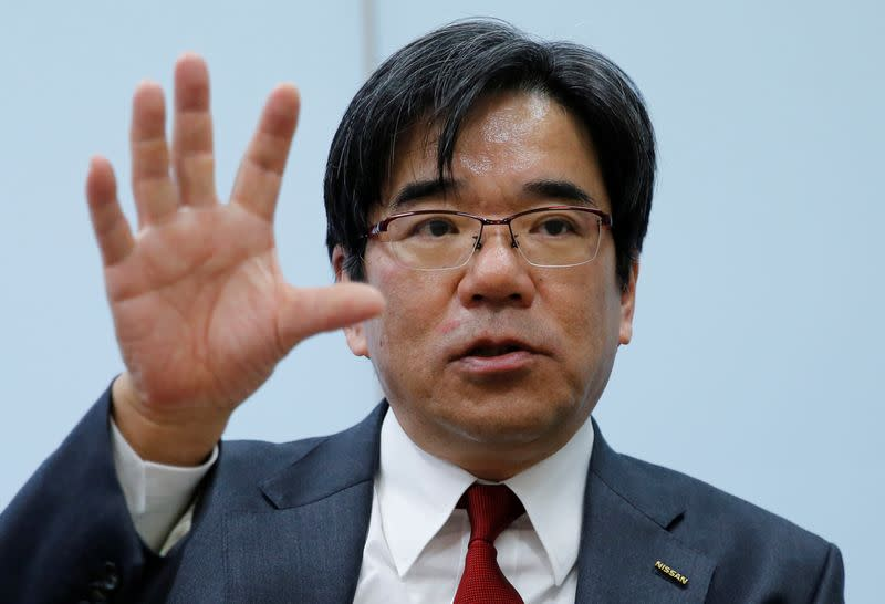 FILE PHOTO: Nissan Executive Vice President Sakamoto speaks during an interview with Reuters at the carmaker's headquarters in Yokohama