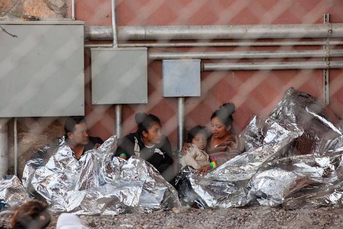 Migrants held in temporary fencing underneath the Paso Del Norte Bridge await processing on March 28, 2019 in El Paso, Texas. U.S. Customs and Border Protection has temporarily closed all highway checkpoints along the 268-mile stretch of border in the El Paso sector to try to stem a surge in illegal entry.  (Photo by Christ Chavez/Getty Images)