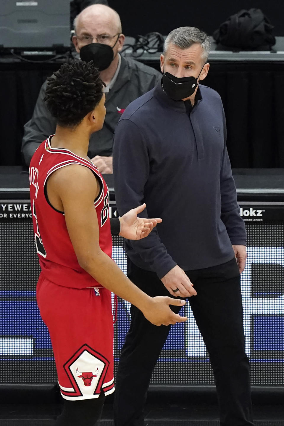 Chicago Bulls head coach Billy Donovan, right, talks with guard Devon Dotson during the first half of an NBA basketball game against the Milwaukee Bucks in Chicago, Sunday, May 16, 2021. (AP Photo/Nam Y. Huh)