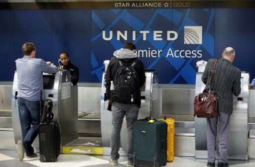 United reports solid profits, vows better customer treatment