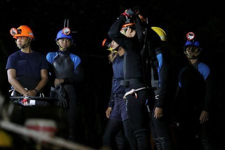 Thai divers gather before they enter to the Tham Luang cave in the northern province of Chiang Rai
