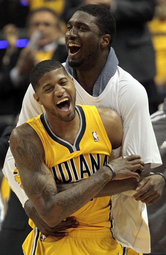 Indiana Pacers forward Paul George, front, and center Roy Hibbert react to a basket in the second half during Game 7 of a first-round NBA basketball playoff series against the Atlanta Hawks in Indianapolis, Saturday, May 3, 2014. The Pacers won 92-80. (AP Photo/AJ Mast)