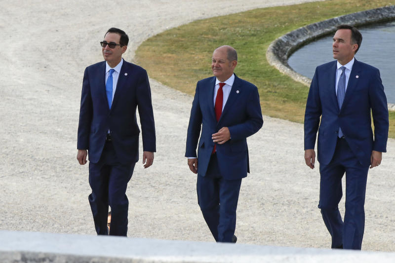 US Treasury Secretary Steve Mnuchin, German Finance Minister Olaf Scholz and Canada's Finance Minister Bill Morneau, from left, walk at the G-7 Finance in Chantilly, north of Paris, on Wednesday, July 17, 2019. The Group of Seven rich democracies' top finance officials gathered Wednesday at a chateau near Paris in search of common ground on the threats posed by digital currencies. (AP Photo/Michel Euler)
