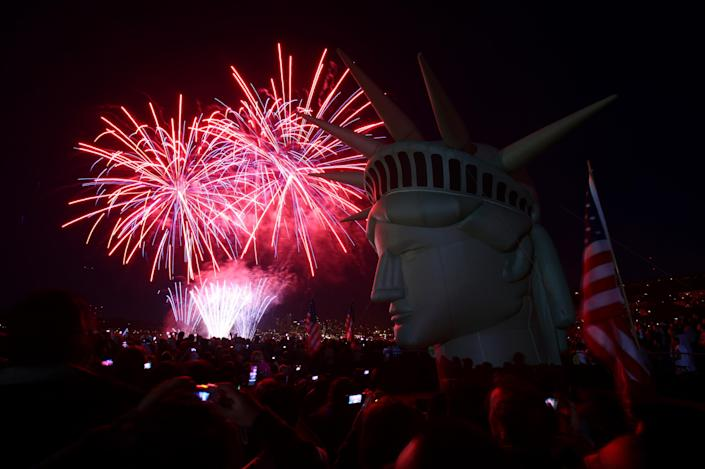 Fireworks explode behind a life-size, inflatable head of the Statue of Liberty on Monday, July 4, 2011 at Gas Works Park in Seattle during the Family 4th on Lake Union celebration. All across the country, Americans marked the 235th anniversary of the signing of the Declaration of Independence. (AP Photo/seattlepi.com, Joshua Trujillo)