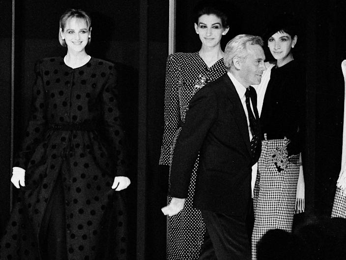 "Armani at a fashion show in Milan in 1985. <p class=""copyright"">AP Photo</p>"