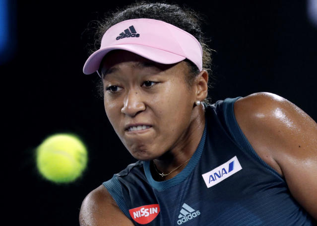 Japan's Naomi Osaka hits a backhand return to Poland's Magda Linette during their first round match at the Australian Open tennis championships in Melbourne, Australia, Tuesday, Jan. 15, 2019. (AP Photo/Kin Cheung)