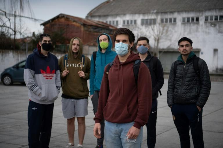 Uruguayan Felipe Paz (front) poses with friends before playing football in Montevideo on August 6, 2020, amid the new coronavirus pandemic