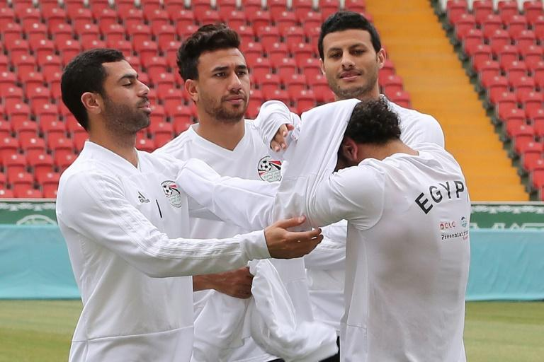 Mohamed Salah needed the help of three teammates to put on a training top