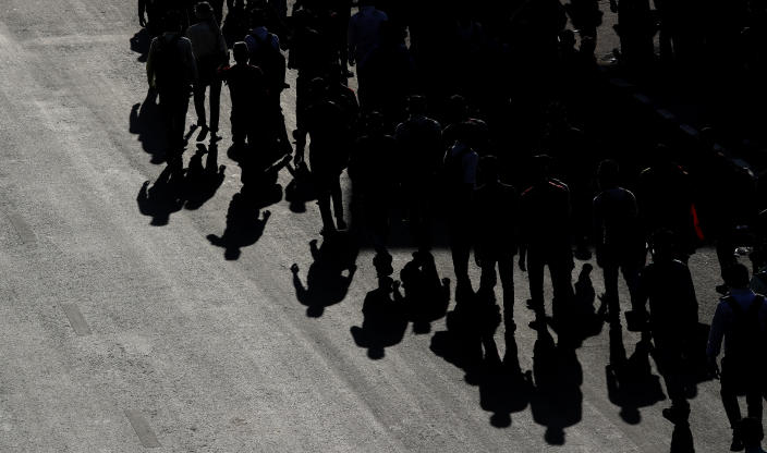 Migrant daily wage laborers make the journey to their respective villages on foot following a lockdown amid concern over spread of coronavirus in New Delhi, India, Friday, March 27, 2020. (AP Photo/Manish Swarup)