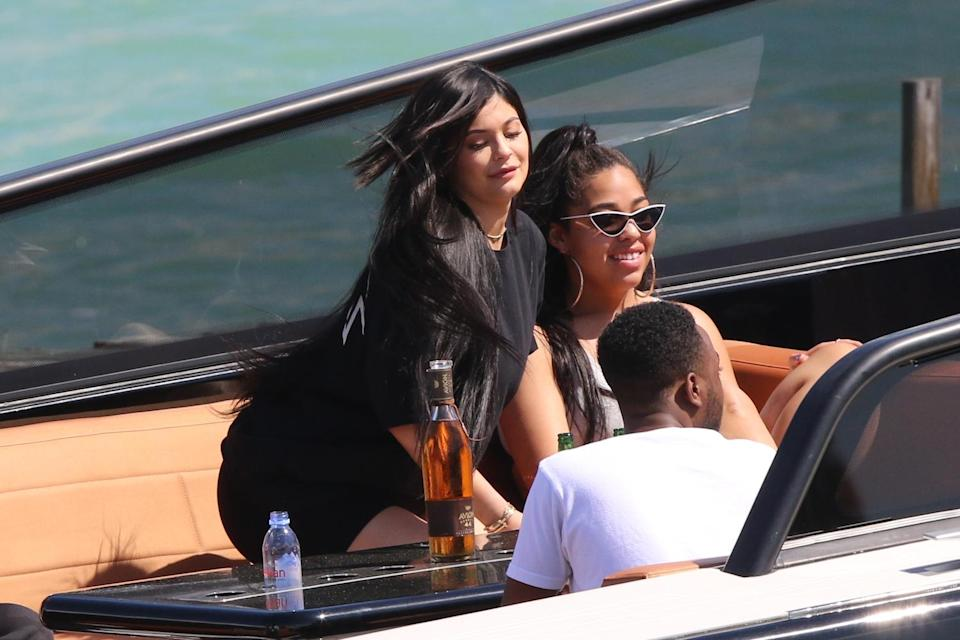New mother Kylie Jenner was seen kicking back on a boat in Miami with baby daddy Travis Scott and friends. (Photo: Splash News)