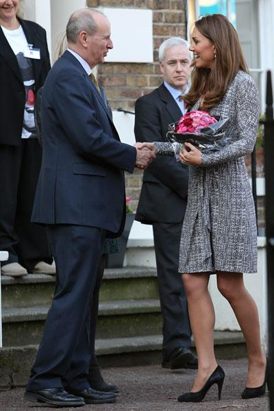 <p>A Caribbean 'babymoon' sure did the trick. Kate Middleton was glowing at her first official public appearance since her vacation with husband Prince William. The tanned Duchess showed off a burgeoning baby bump Tuesday morning while visiting Hope House in London, a treatment centre run by the charity Action on Addiction. (Photo by Neil Mockford/FilmMagic)</p>