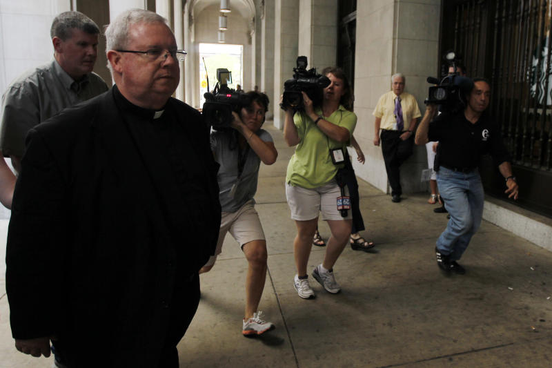 Monsignor William Lynn walks from the Criminal Justice Center, Wednesday, June 20, 2012, in Philadelphia. The jury in a landmark U.S. clergy abuse trial says it is hung on four of the five charges, and the judge has sent the jurors back to deliberate further. Lynn is the first Roman Catholic church official in the U.S. ever charged with child endangerment, for allegedly keeping co-defendants former priest Edward V. Avery and the Rev. James J. Brennan, and other accused predators, in ministry. (AP Photo/Matt Rourke)