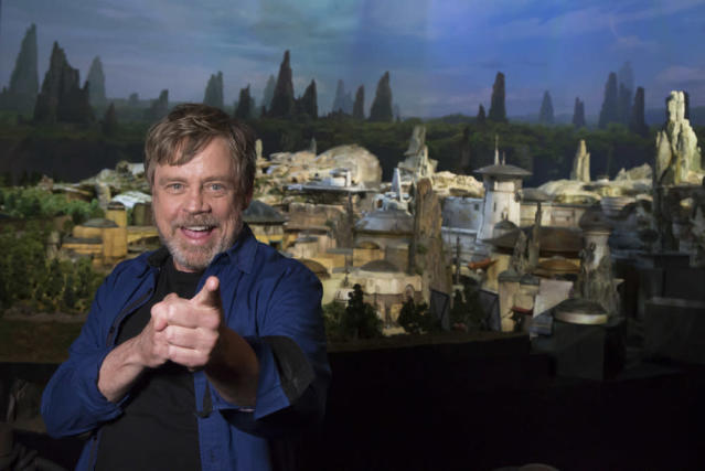 "<p>Mark Hamill was on hand to unveil the name of <a href=""https://www.yahoo.com/movies/disneys-star-wars-land-concept-slideshow-wp-022947702.html"" data-ylk=""slk:the new 14-acre land;outcm:mb_qualified_link;_E:mb_qualified_link"" class=""link rapid-noclick-resp newsroom-embed-article"">the new 14-acre land</a> during D23 Expo. (Joshua Sudock/Disney Parks) </p>"