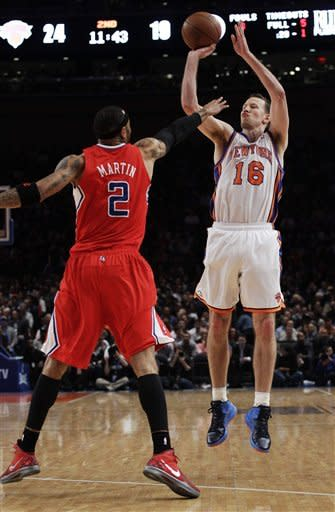 New York Knicks' Steve Novak (16) shoots over Los Angeles Clippers' Kenyon Martin (2) during the first half of an NBA basketball game, Wednesday, April 25, 2012, in New York. (AP Photo/Frank Franklin II)