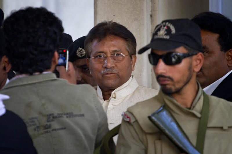 Pakistan's former president and military ruler Pervez Musharraf, center, leaves after appearing in court in Rawalpindi, Pakistan on Wednesday, April 17, 2013. Musharraf appeared in court to seek bail in Benazir Bhutto's assassination case. Pakistan's Supreme Court ordered Musharraf to respond to allegations that he committed treason while in power, and barred him from leaving the country only weeks after he returned. (AP Photo/Anjum Naveed)