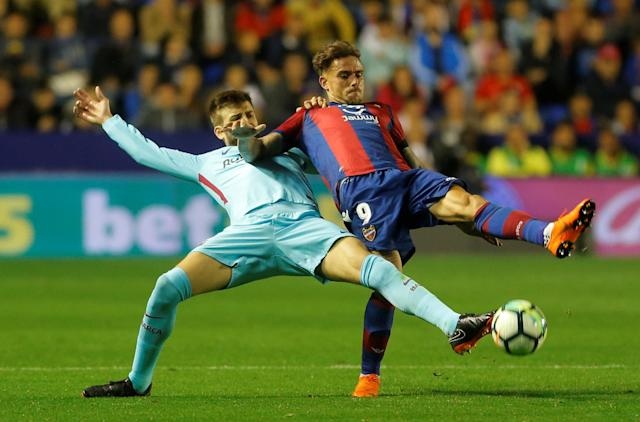 Soccer Football - La Liga Santander - Levante vs FC Barcelona - Ciutat de Valencia, Valencia, Spain - May 13, 2018 Levante's Roger Marti in action with Barcelona's Gerard Pique REUTERS/Heino Kalis