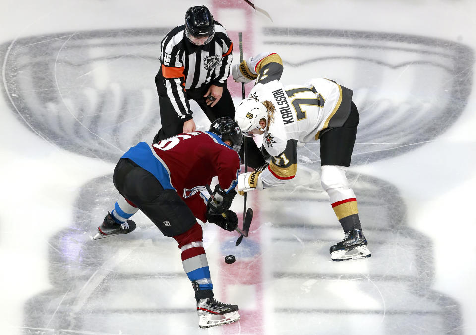 EDMONTON, ALBERTA - AUGUST 08:  Mikko Rantanen #96 of the Colorado Avalanche and William Karlsson #71 of the Vegas Golden Knights battle for the face-off during the second period in a Western Conference Round Robin game during the 2020 NHL Stanley Cup Playoff at Rogers Place on August 08, 2020 in Edmonton, Alberta. (Photo by Jeff Vinnick/Getty Images)