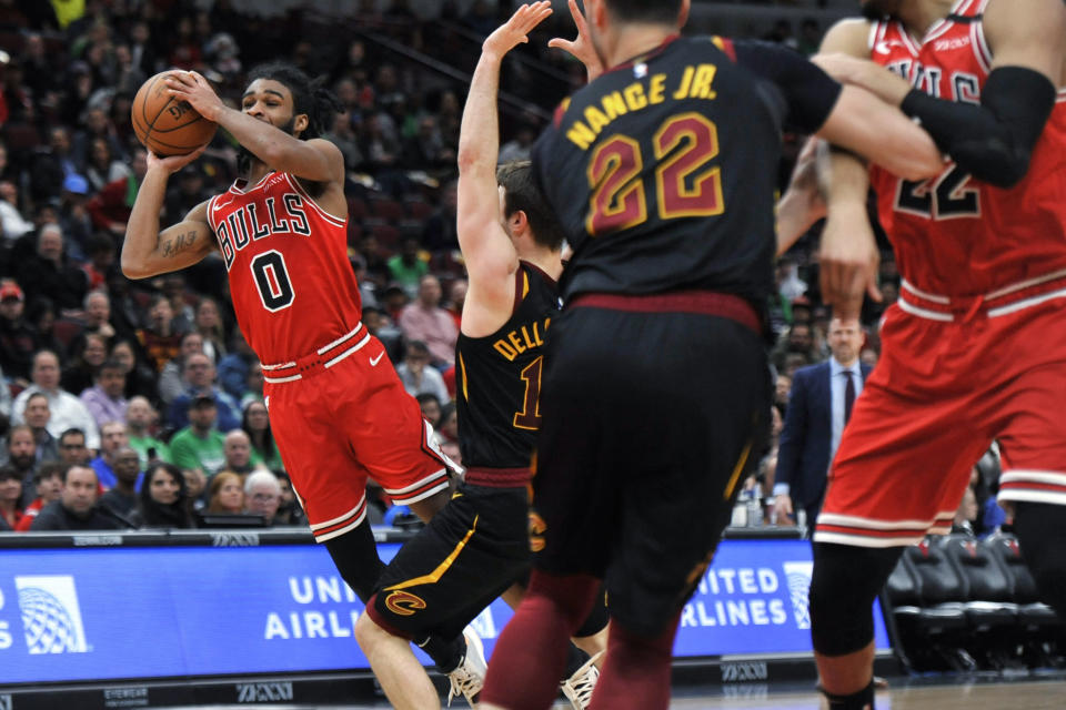 Chicago Bulls' Coby White (0) tries for a shot during the second half of the team's NBA basketball game against the Cleveland Cavaliers on Tuesday, March 10, 2020, in Chicago. (AP Photo/Paul Beaty)