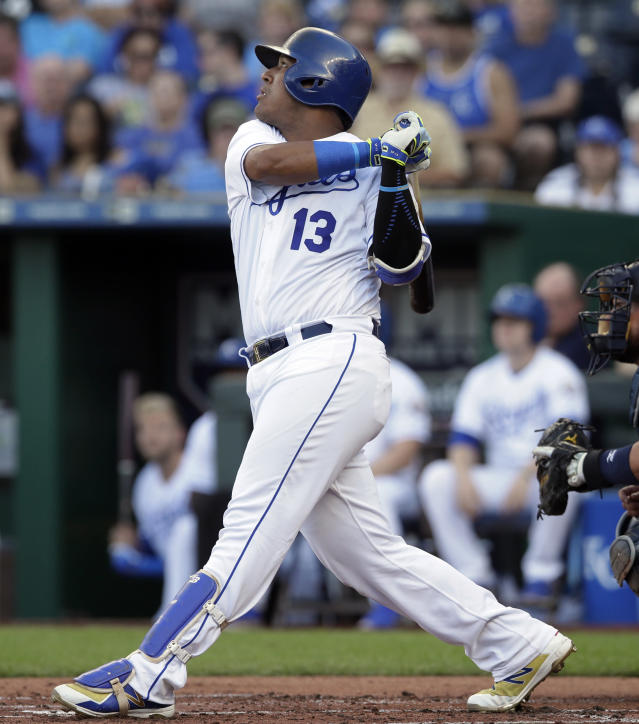 Kansas City Royals' Salvador Perez watches his two-run home run off Minnesota Twins starting pitcher Lance Lynn during the first inning of a baseball game at Kauffman Stadium in Kansas City, Mo., Saturday, July 21, 2018. (AP Photo/Orlin Wagner)