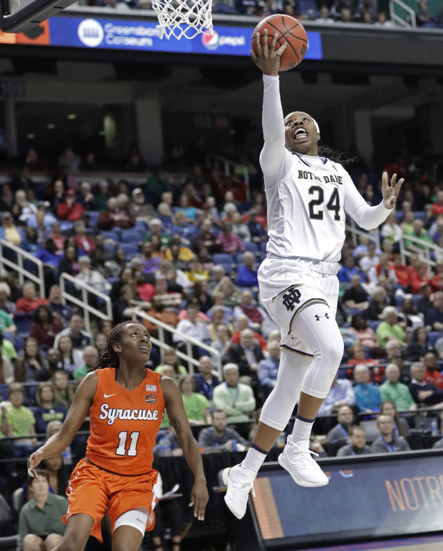 FILE- In this March 9, 2019, file photo Notre Dame's Arike Ogunbowale (24) drives to the basket past Syracuse's Gabrielle Cooper (11) during the second half of an NCAA college basketball game in the Atlantic Coast Conference tournament in Greensboro, N.C. The heroine of Notre Dames national championship run last year, who won both Final Four and title games with dramatic, last-second shots, is ready for her last ride through the bracket, starting Saturday when the Fighting Irish takes on Bethune-Cookman in the first round. (AP Photo/Chuck Burton, File)