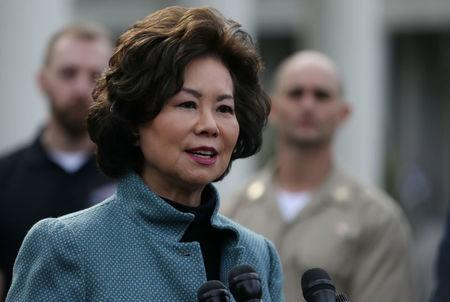 U.S. Secretary Elaine Chao speaks to the news media outside of the West Wing of the White House