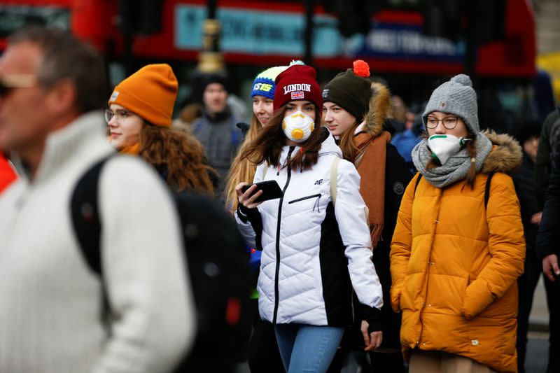 People are pictured wearing protective face masks in London
